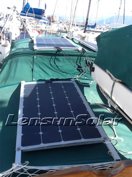 Lensun flexible solar panels are mounted by holes and frame on the fabric of sailboat